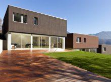 Przygotuj nowoczesny projekt ocieplenia i elewacji budynku w szarym lub czarnym kolorze